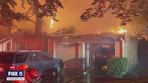 Firefighter rescued from burning townhome