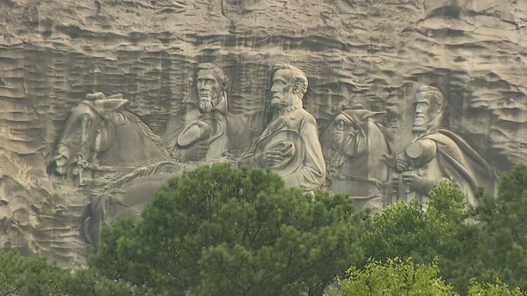 Armed protesters make statement during march at Stone Mountain Park
