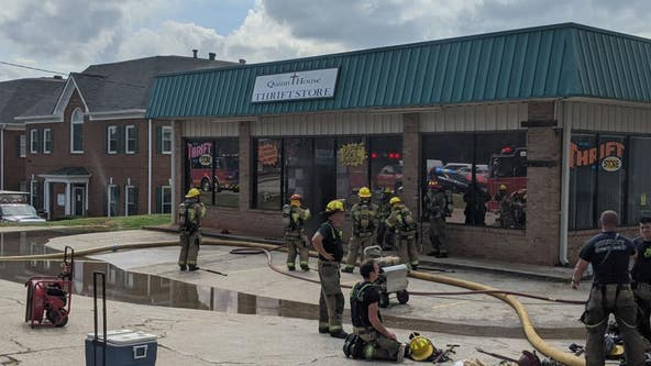 Crews work to contain fire at a Gwinnett County business