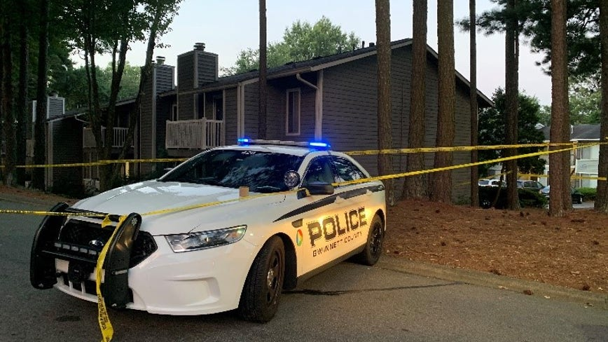 Police identify man found dead at Gwinnett County apartments, three suspects charged
