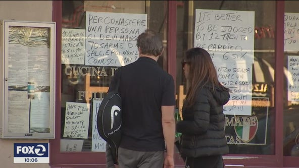 Shuttered North Beach restaurant plasters polarizing messages in its windows