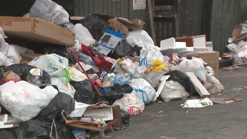 Large piles of trash sit outside Atlanta apartment complex for weeks