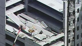 Firefighters rescue worker after partial collapse of midtown Atlanta parking garage