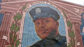 Family, local officials gather to denounce the defacing of Sgt. Wilson mural