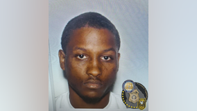Police: Man wanted for gunning down woman in front of their young children