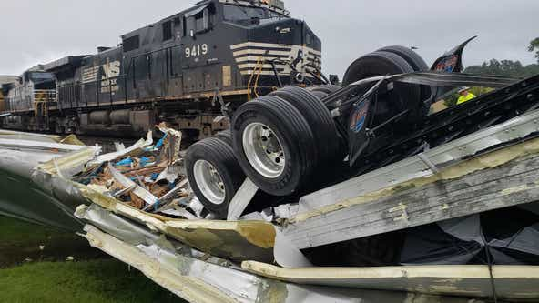 Train slams into tractor trailer in Villa Rica: Caught on camera