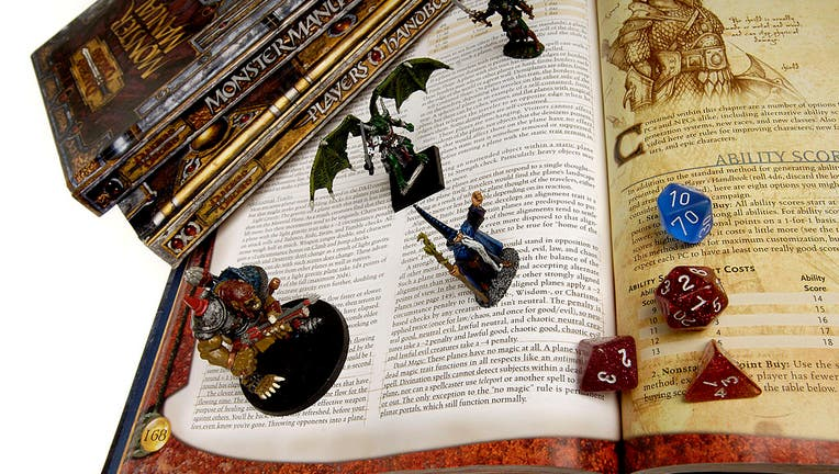 Books, die, figurines from Dungeons and Dragons to go with story on the game's creator, Gary Gygax