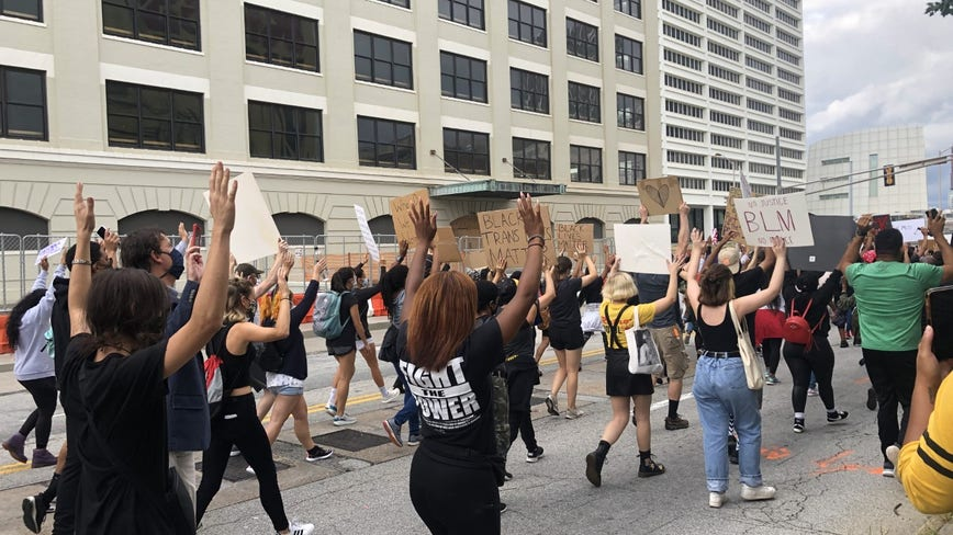 Vocal group marches in downtown Atlanta demanding change and accountability