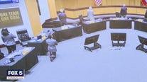 School board member takes knee during pledge