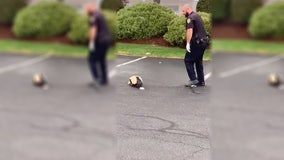 Police officer helps skunk with head stuck in container