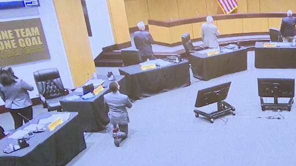 Cobb County School Board member takes a kneed during Pledge