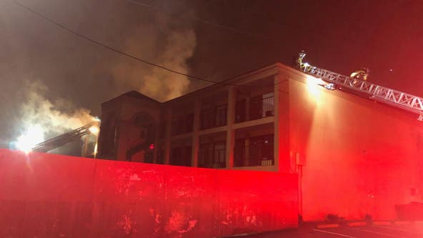 Firefighter rescued while battling DeKalb County hotel blaze