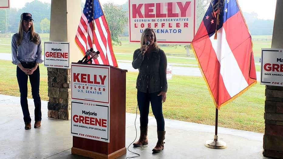 U.S. House candidate for Georgia Marjorie Taylor Greene (right) and U.S. Sen. Kelly Loeffler (left) at a joint campaign event in Dallas, GA.