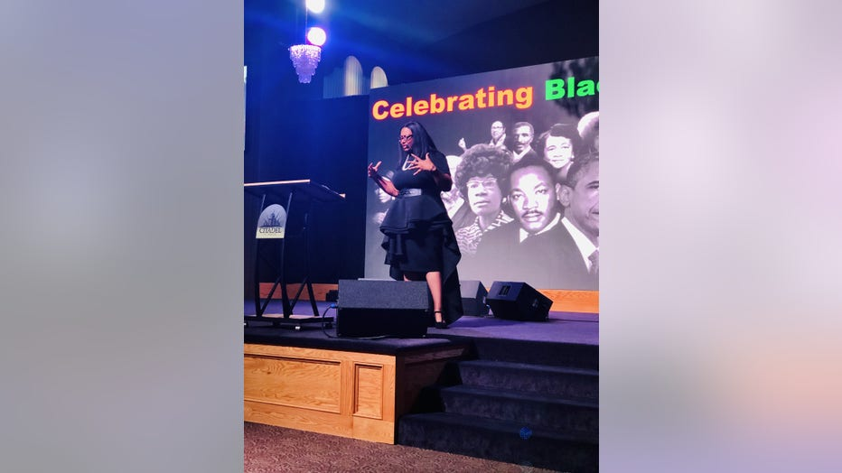 Woman speaks on stage at event