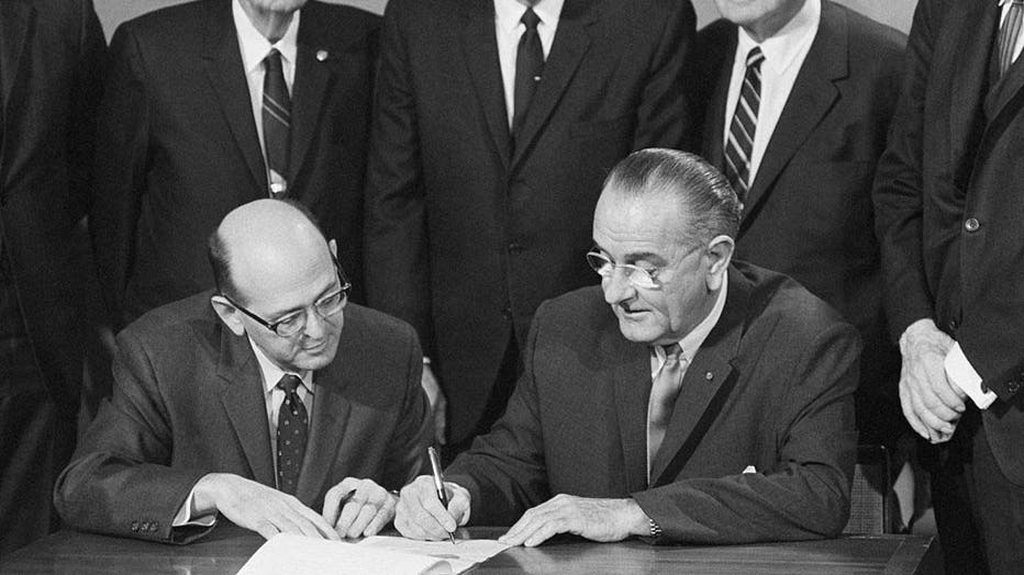 President Johnson Signing Amendment