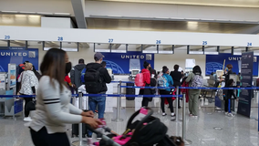 Travelers pack Atlanta airport for busy Thanksgiving travel day