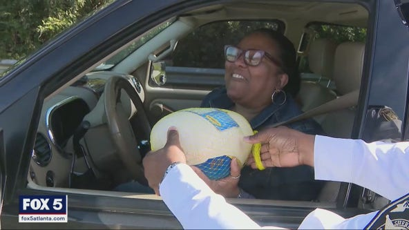 Rockdale County residents receive unexpected gifts during impromptu traffic stops