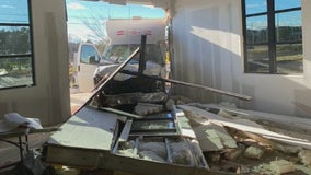 Truck crashes into Suwanee shopping complex