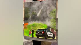 Painting captures an officer's compassion