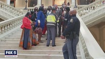 State lawmaker, state police clash during voting bill protest