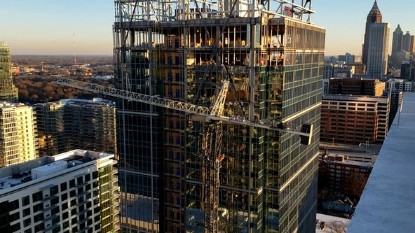 Crane in Midtown 'reinforced' as crews work to dismantle it