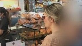 Video: Woman hurls racial slurs at bagel shop worker