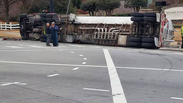 Gwinnett County fire department still working to remove overturned fuel tanker on Hamilton Mill Road
