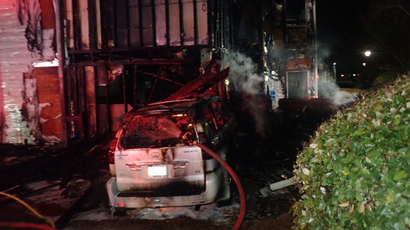 Arrest made after car crash sparks apartment fire