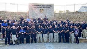 Wounded officer's son accepts academic honor, Carrollton PD attends