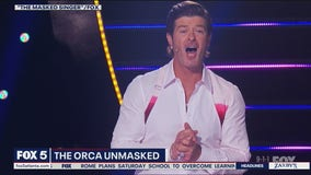 Paul reacts to the latest Masked Singer reveal