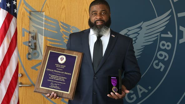Officer struck by ATV during protest stands to receive Purple Heart