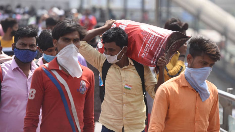 Migrant Workers Return To Their Native Place Amid Fears Of A Total Lockdown Due To The Surge In Covid-19 Case