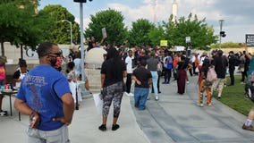 Demonstrators rally in downtown Atlanta to honor George Floyd one year after murder