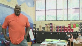 Shaq helps gift hundreds of new shoes to elementary school students