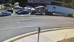 Truck driver charged after pushing car into an intersection