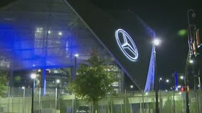 Woman shot while driving near Mercedes-Benz Stadium, police say