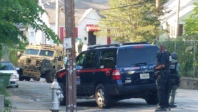 SWAT team called after officers serving a warrant hear gunshots, police say