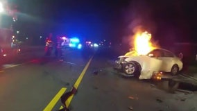Sandy Springs police rescue man from burning car