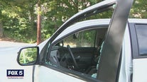 Woman says man smashed her truck window with a flare
