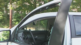 Woman says HERO worker threw flare at her truck and smashed her window
