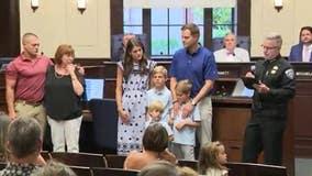 Alpharetta homeowner, Marine honored for saving boys from dog attack