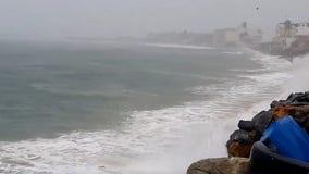 Hurricane Enrique sweeps past Mexico's southwestern coast