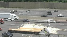 Semi hauling lumber overturns on I-75 causing delays
