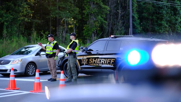 Officer dragged to death behind car, suspect killed at Holly Springs traffic stop