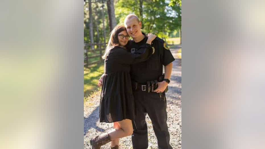 Officer Joe Burson (right) pictured with his wife. The Holly Springs Police Department officer was killed in the line of duty.