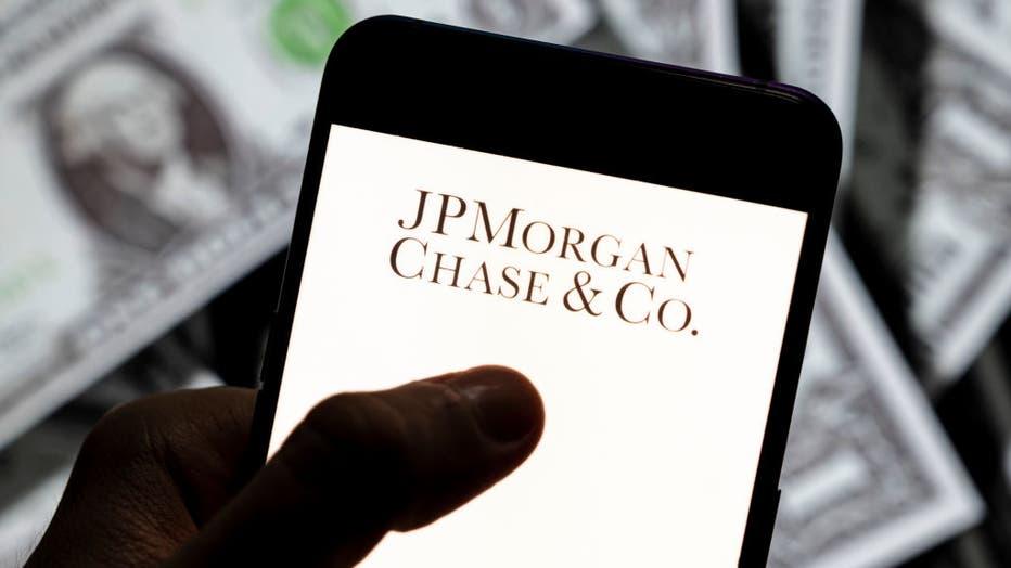 In this photo illustration, a JPMorgan Chase & Co (JP Morgan