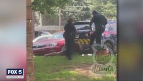 Atlanta police sergeant fired over video showing woman being kicked