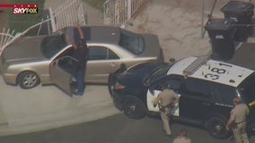 Pursuit suspect surrenders to CHP officers in Downey neighborhood
