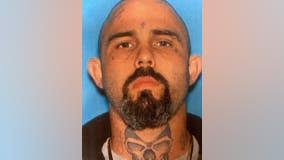 Police: Tattooed suspect runs after caught with stolen car, dog