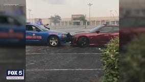 Caught on camera: Driver doing donuts in mall parking lot rammed by state trooper in dramatic pursuit